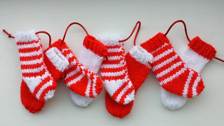 Elegant Knit Christmas Stockings With Multicolorful Christmas Stocking And Fireplace At Chistmas Day Interior Design