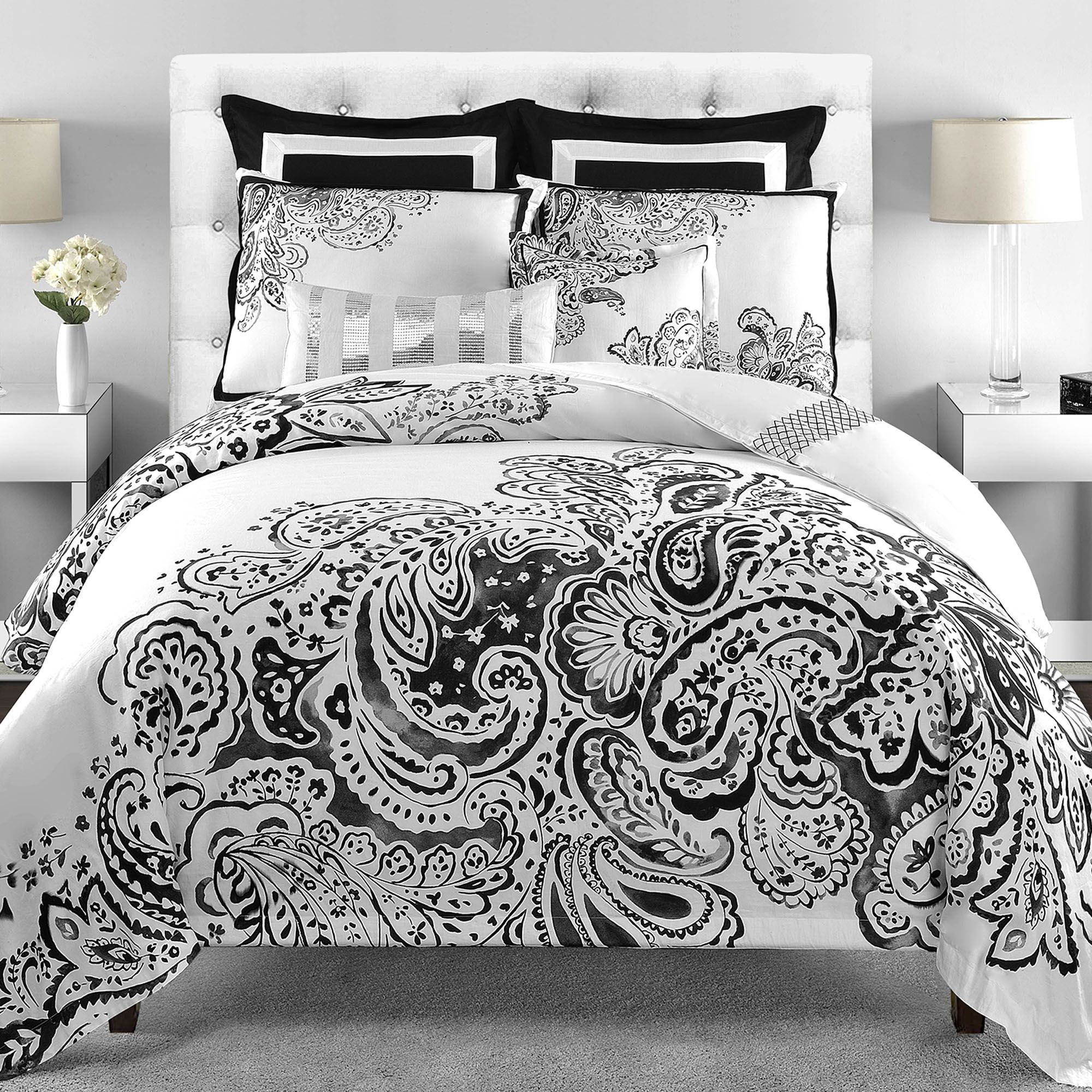 Enchanting Bedroom with black and white comforter sets and laminate porcelain floor also curtain and sidetables