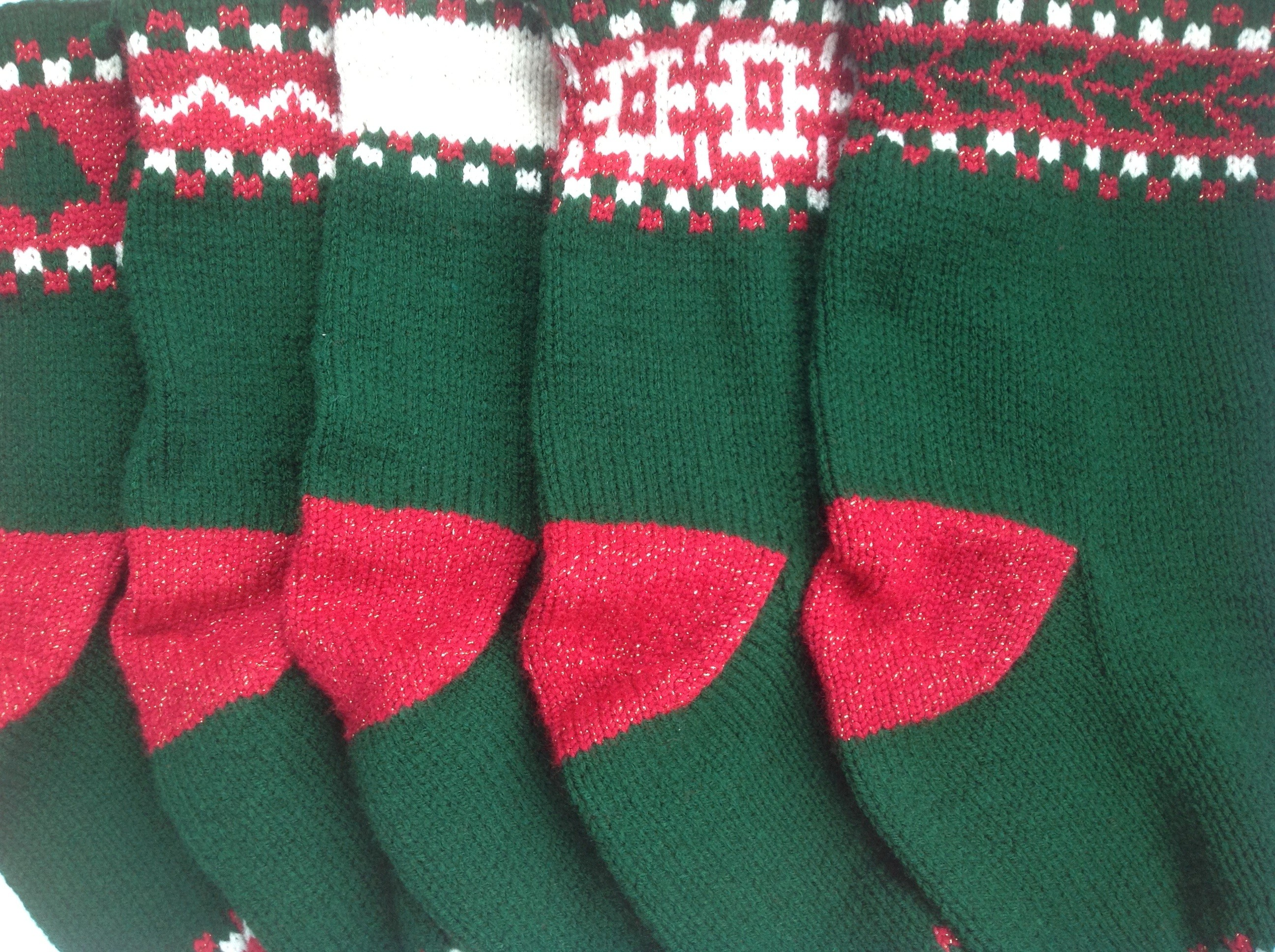 Enchanting knit christmas stockings with multicolorful christmas stocking and fireplace at chistmas day interior design