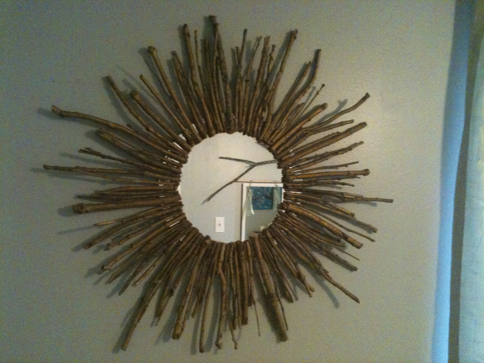 Endearing sunburst mirrors with rustic table and night lap combined plus luxury wall