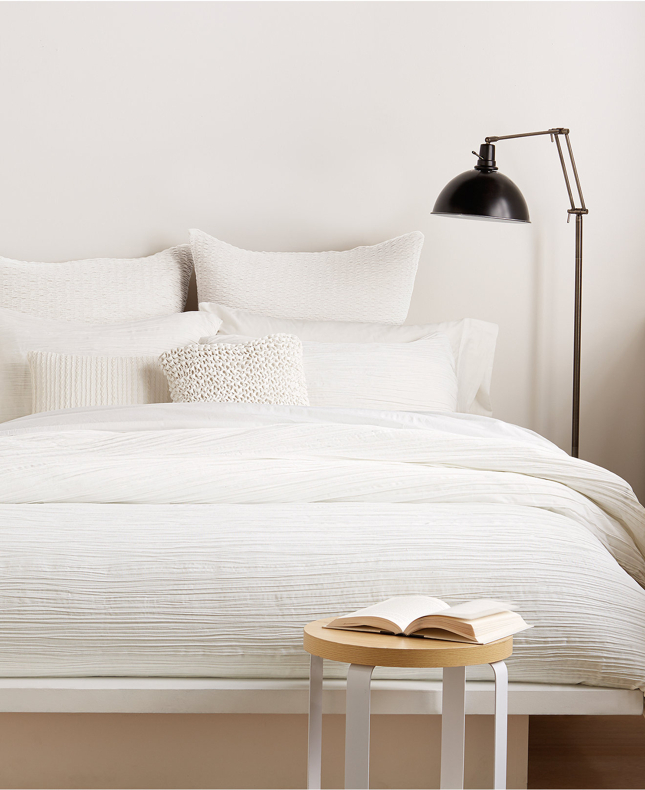 Excellent donna karan bedding with Cushion and pillows also beautiful duvet cover and sidetable and luxury wall paint color
