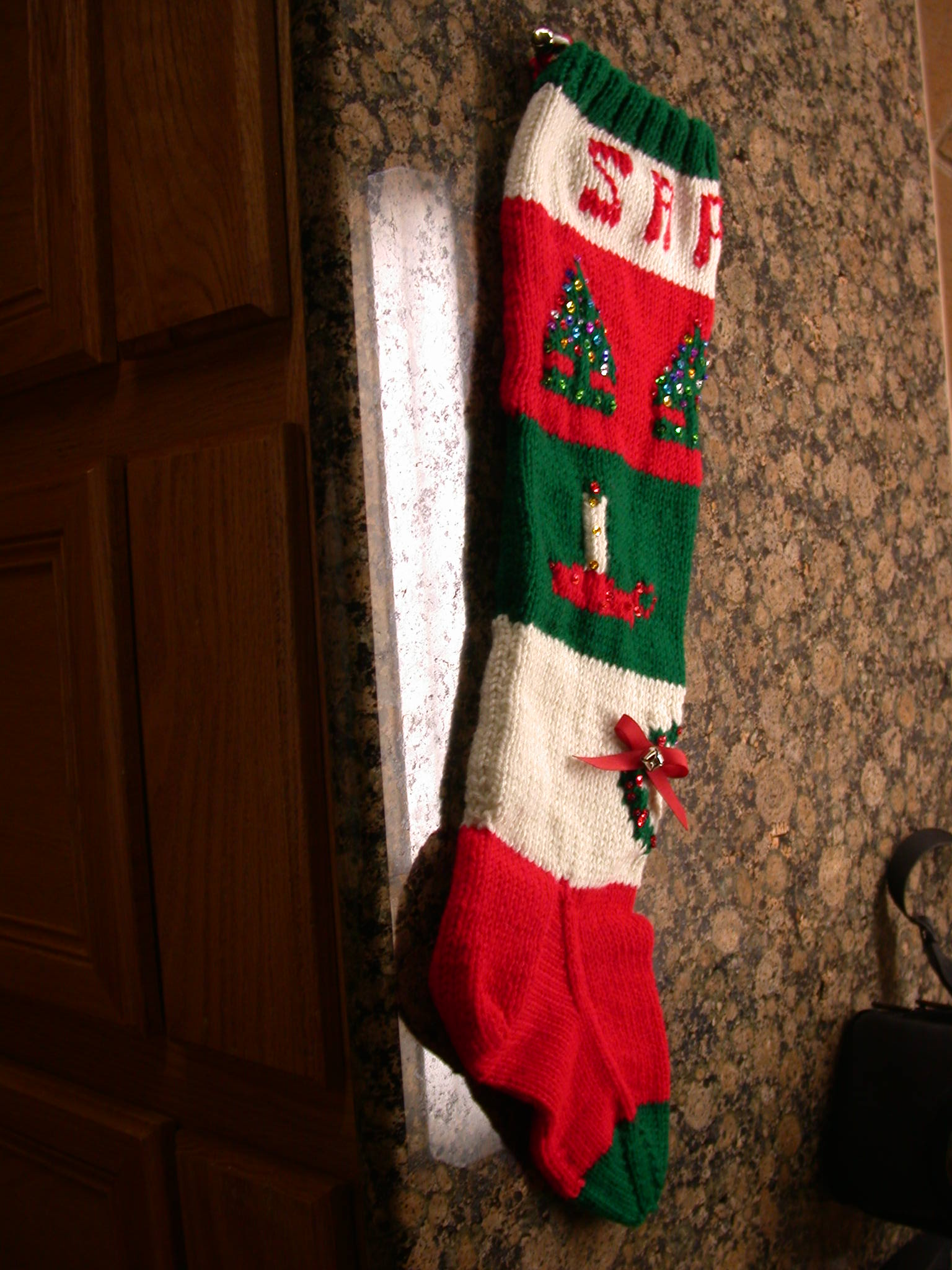 Fabulous knit christmas stockings with multicolorful christmas stocking and fireplace at chistmas day interior design