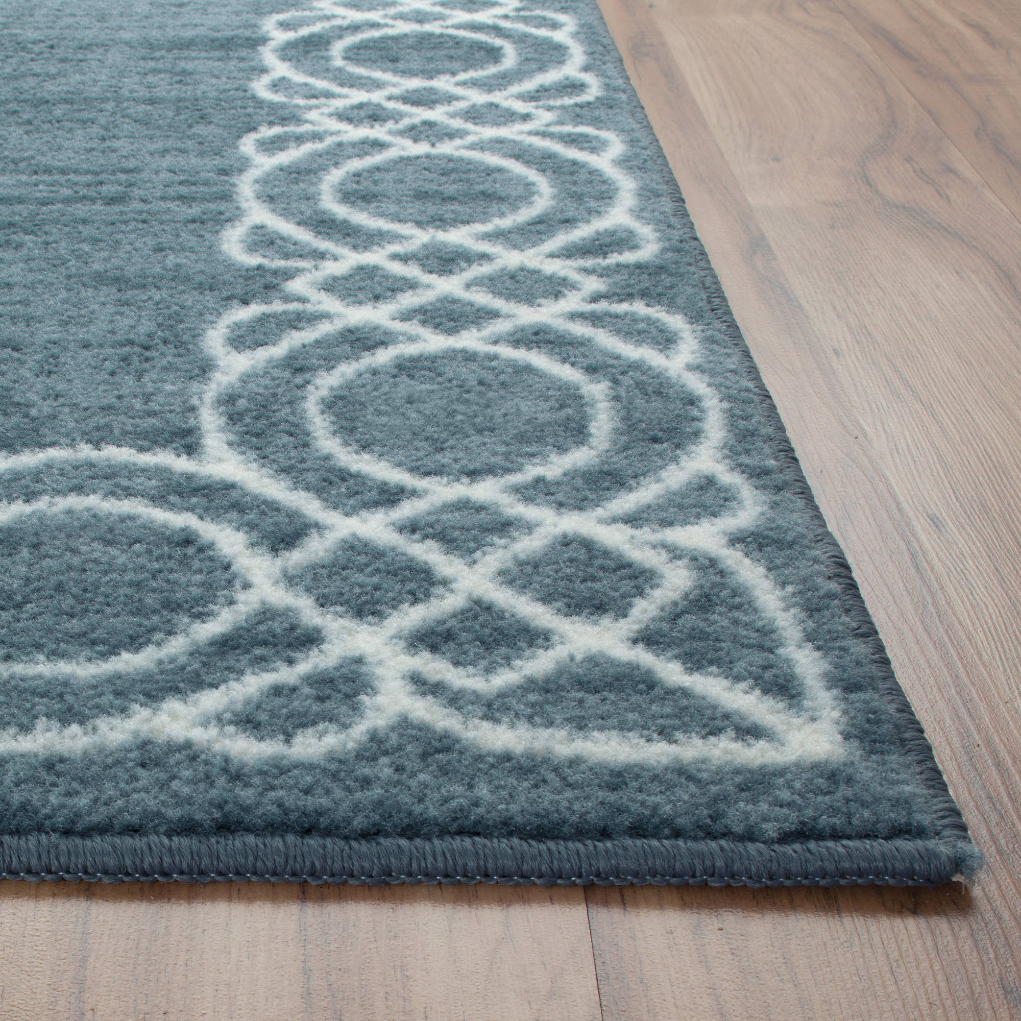 beautiful light blue scroll border maples rugs and laminate floor