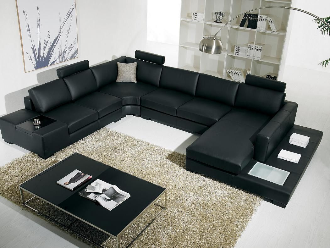 black leather living room sectionals with rug also table and ceramic
