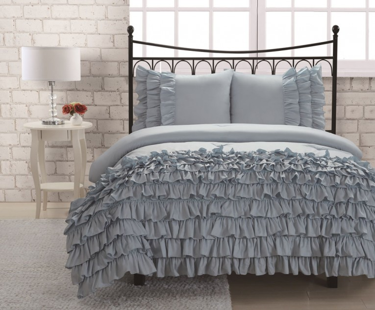 Blue Ruffle Comforter With White Lowes Table