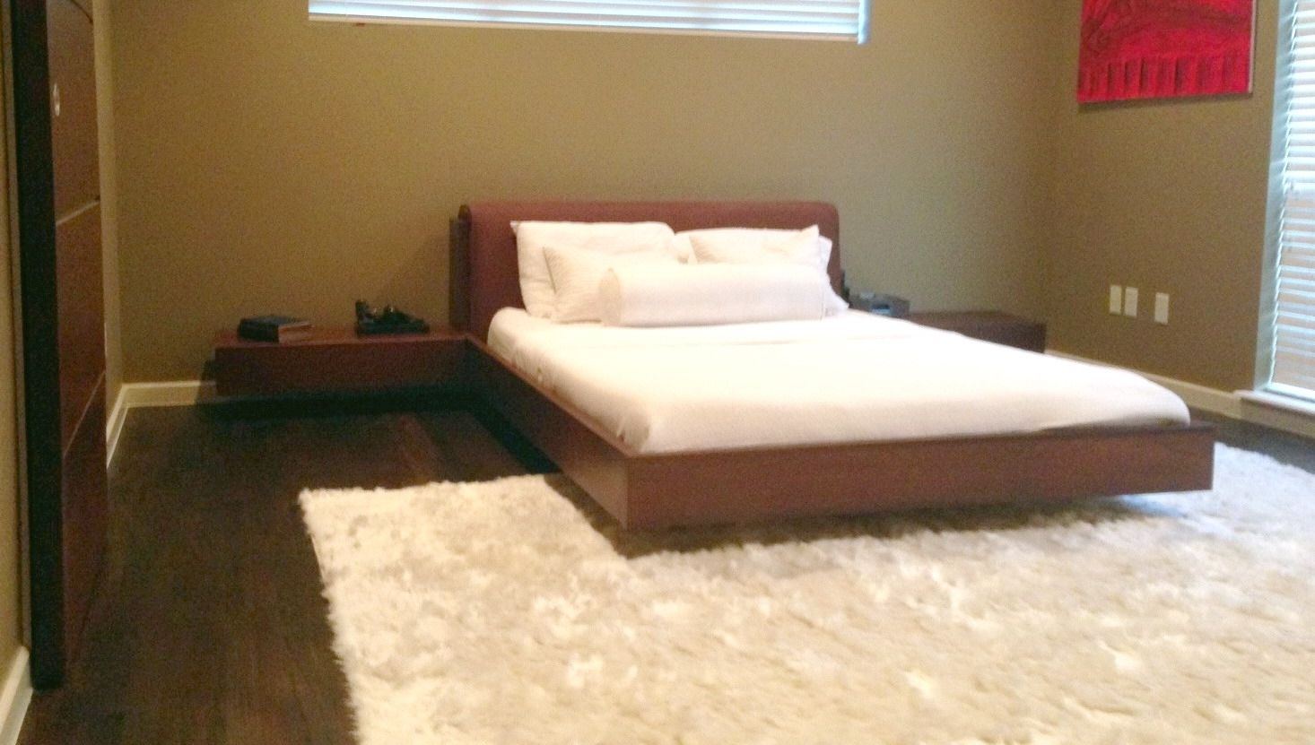 brown queen size platform bed headboard and rugs