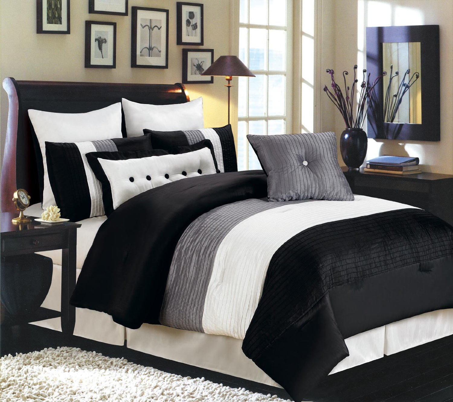 chic Bedroom with black and white comforter sets and laminate porcelain floor also curtain and sidetables