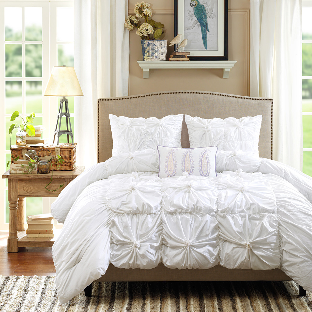 fabric headboard and rug plus sidetable and ruffle comforter