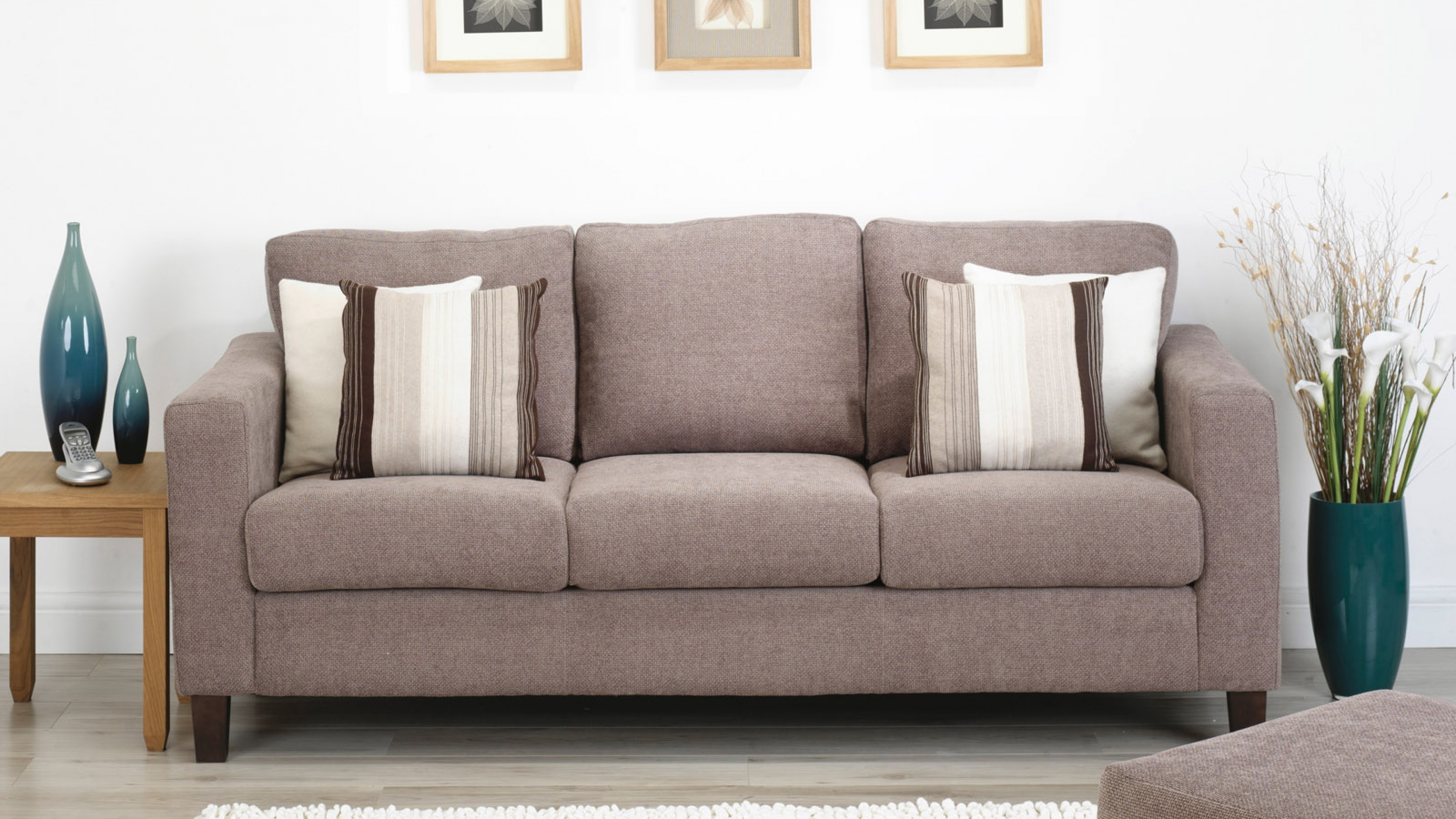 gray sofas with sidetable and sofa pillows
