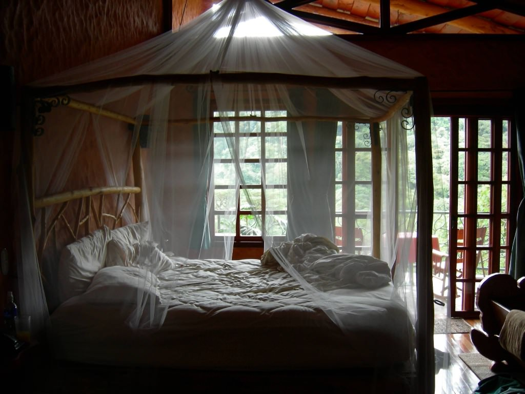 Gorgeous Bedroom Fill with King Size Canopy Bed: Nice King Size Canopy Bed With Chairs And Sliding Glass Door