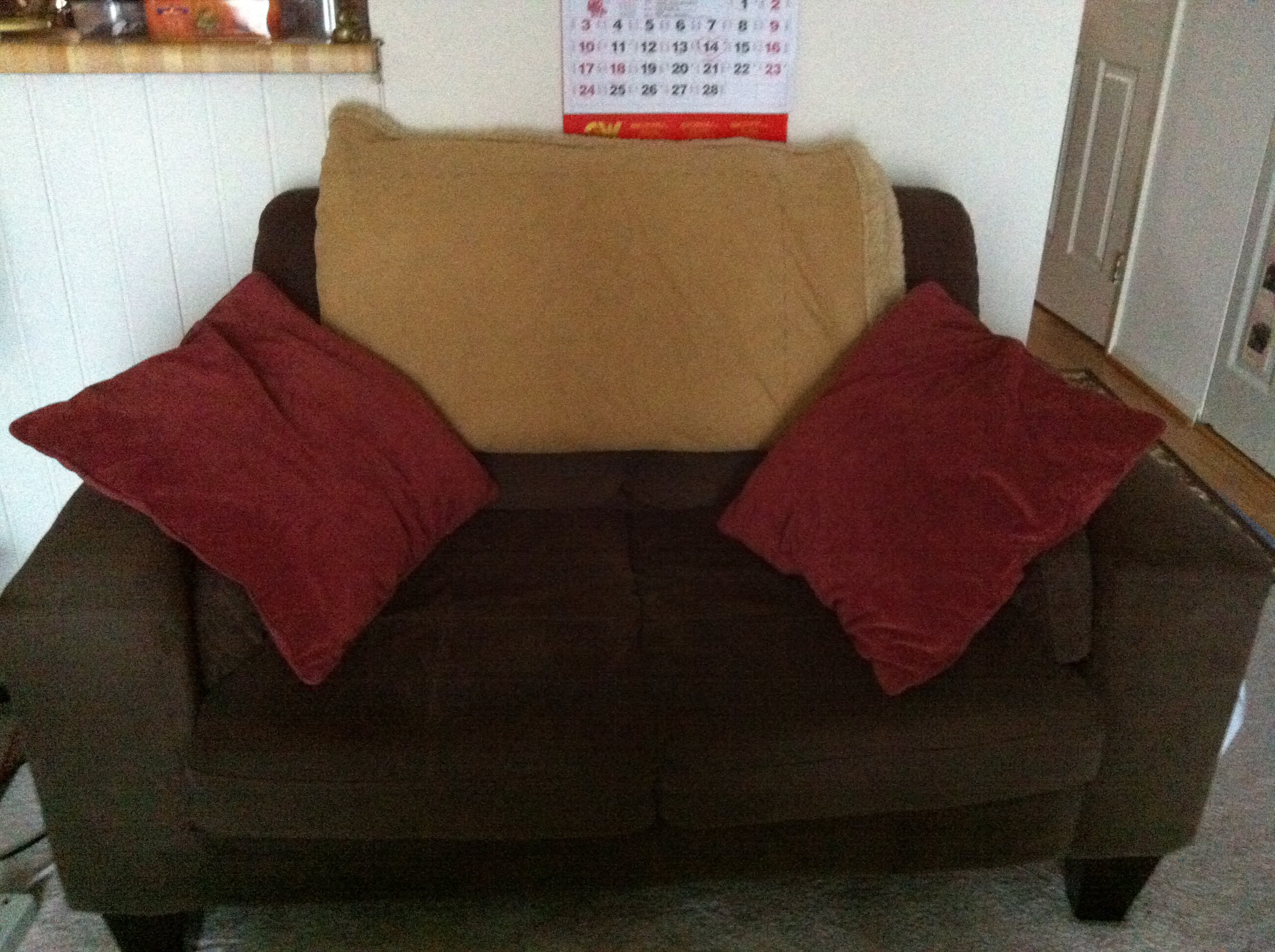red sofa pillows and loveseat