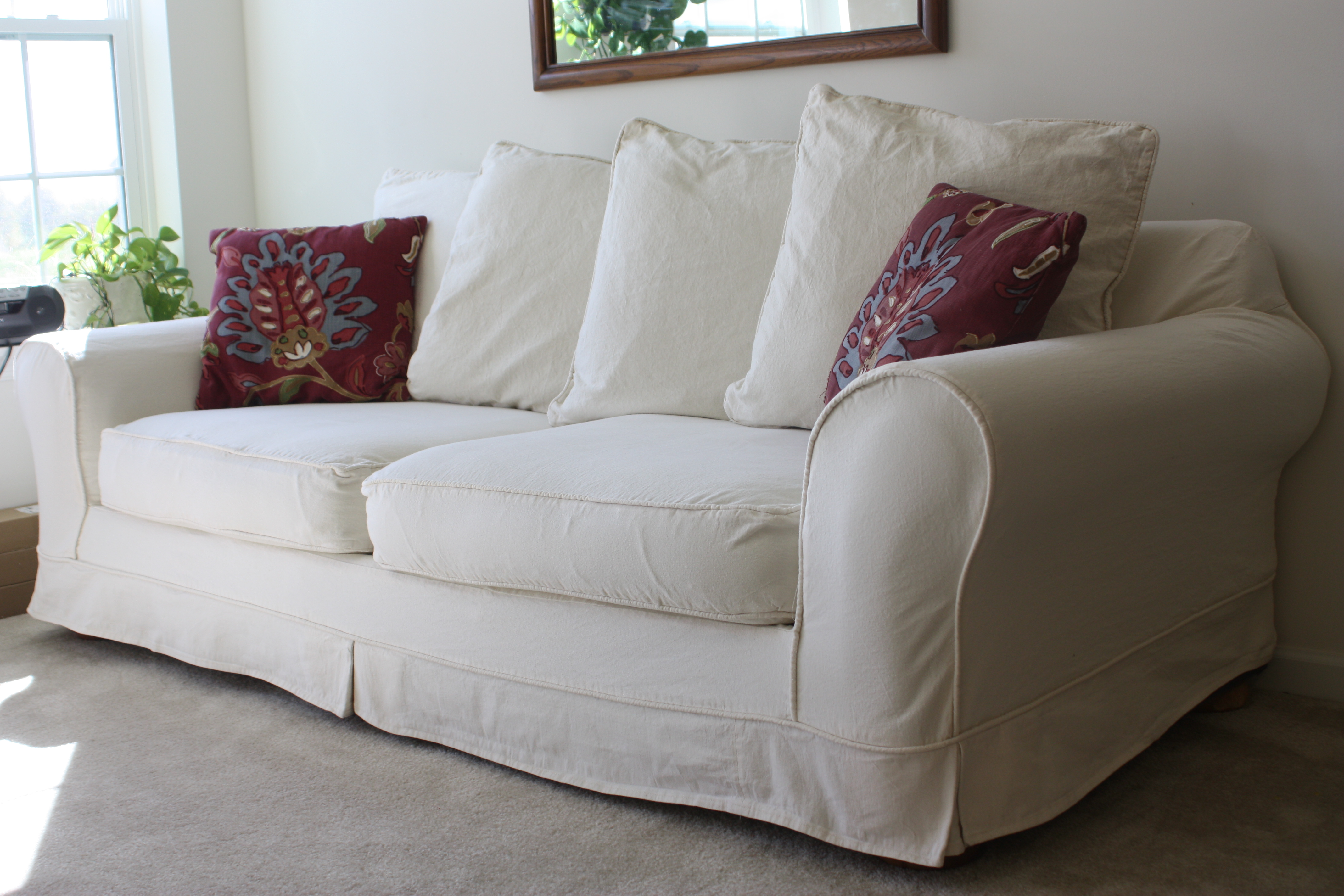 white loveseat sofa and sofa pillows